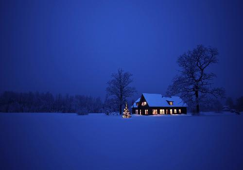 Mountain house in snow