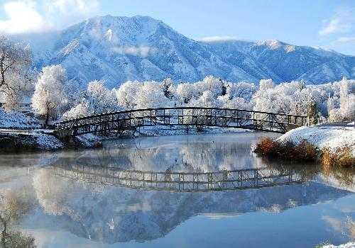 snowy bridge on river